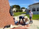 Three men working on ground
