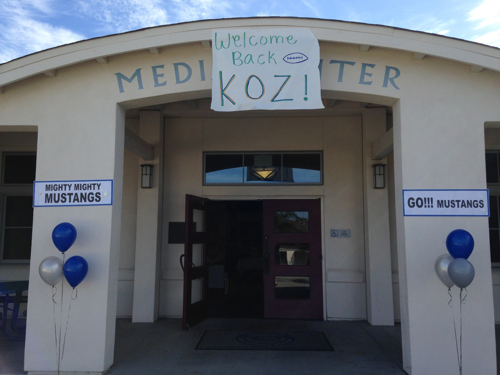 Sign over library says welcome back, Koz