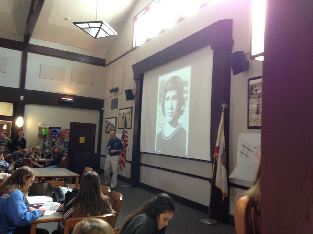 Scott Jordon in front of Mike Kozlowski slideshow