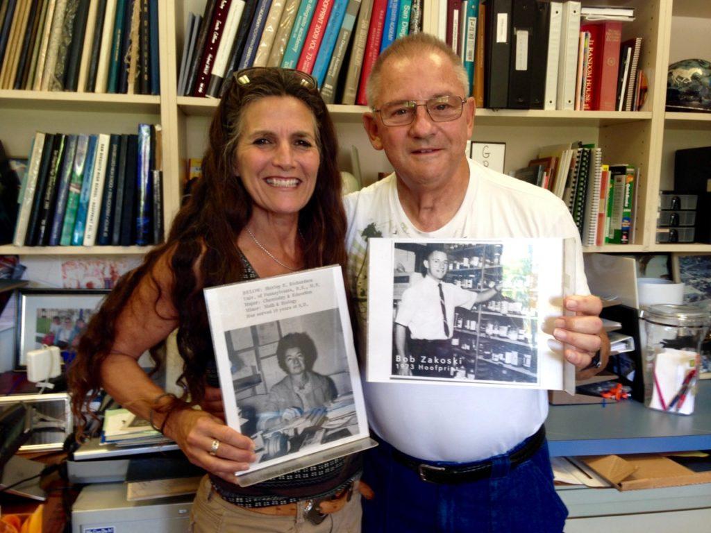 Jennifer and Mr. Zakoski holding up photos of Shirley Richardson and Bob Zakoski