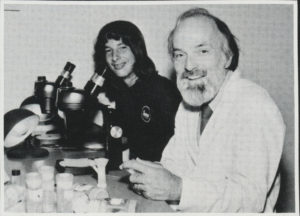 John Hewitson at microscope