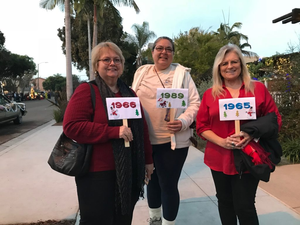 Sue, Stacey and Mickey, holding signs