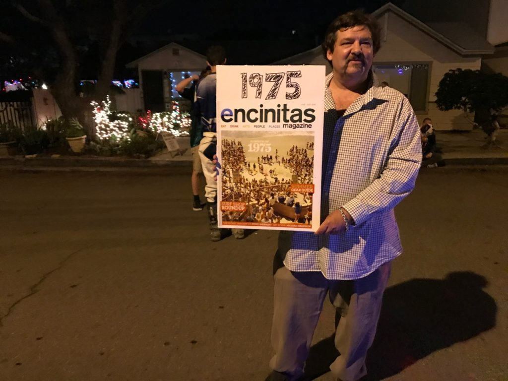 Kyle, holding poster with his photo and 1975