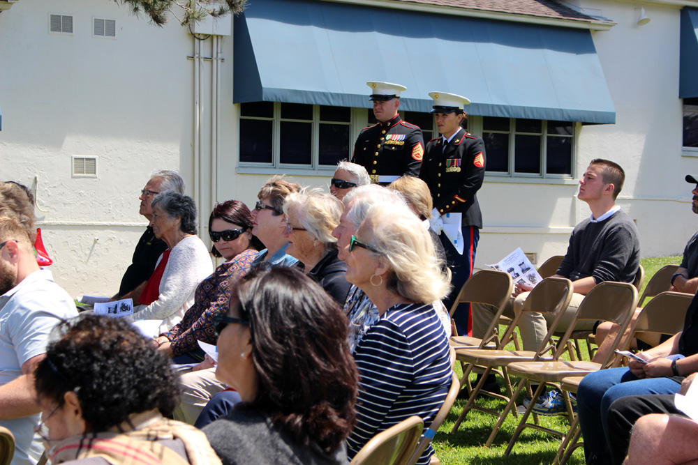 Audience with Marines in background