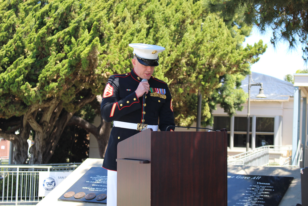 Staff Sgt. Phillips in uniform, at lectern