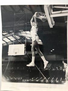 John touches the basketball hoop