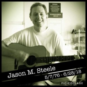 Jason with his guitar