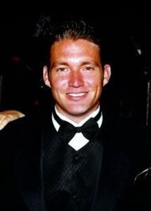 James in tuxedo, smiling
