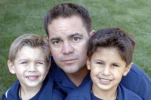 Danny between his two boys