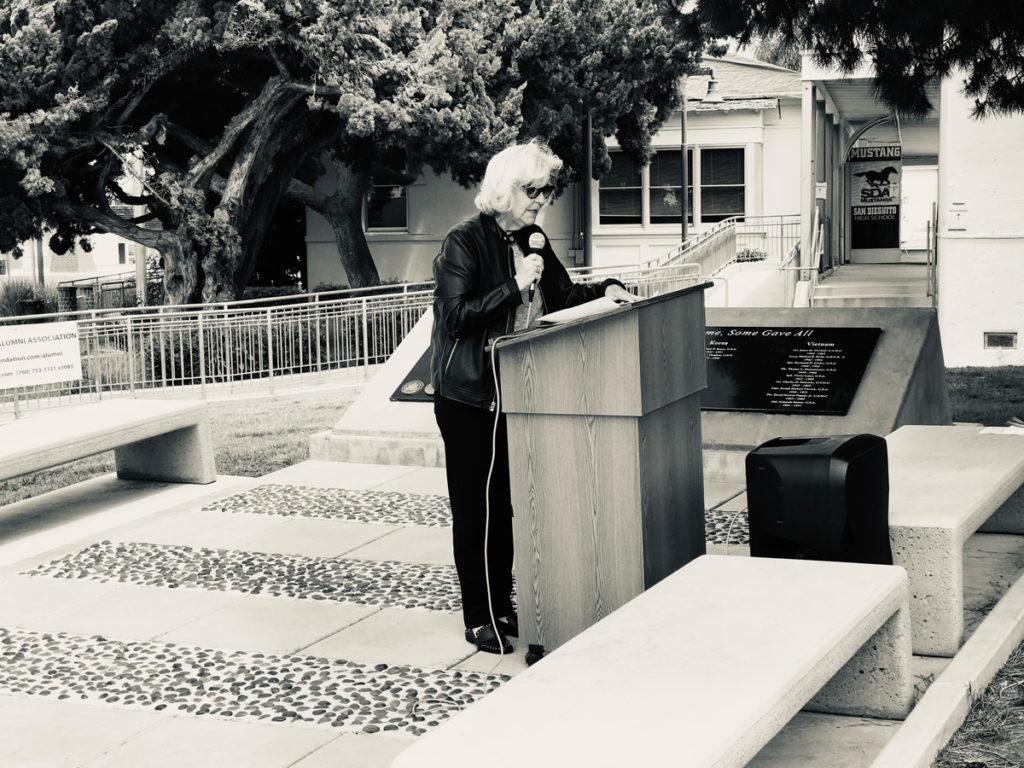 Monica Coughlin at lectern
