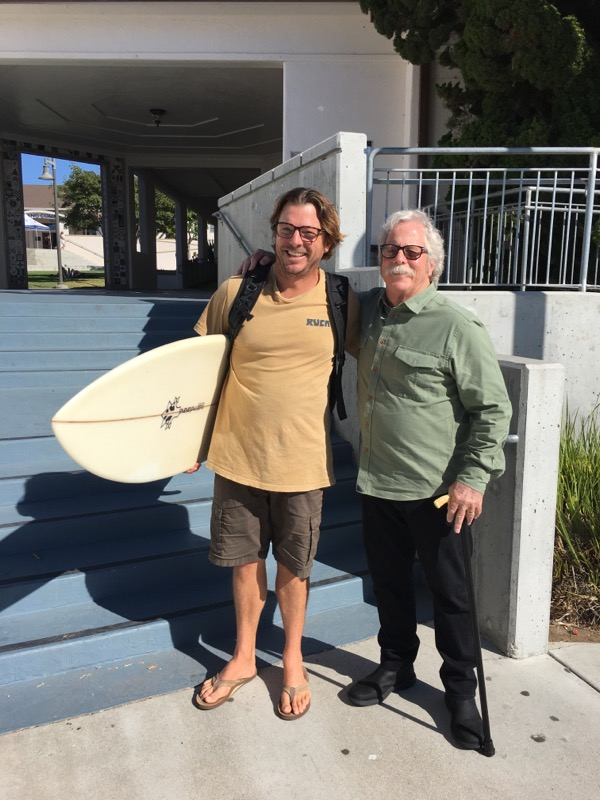 Oly on left with surfboard Chris on right