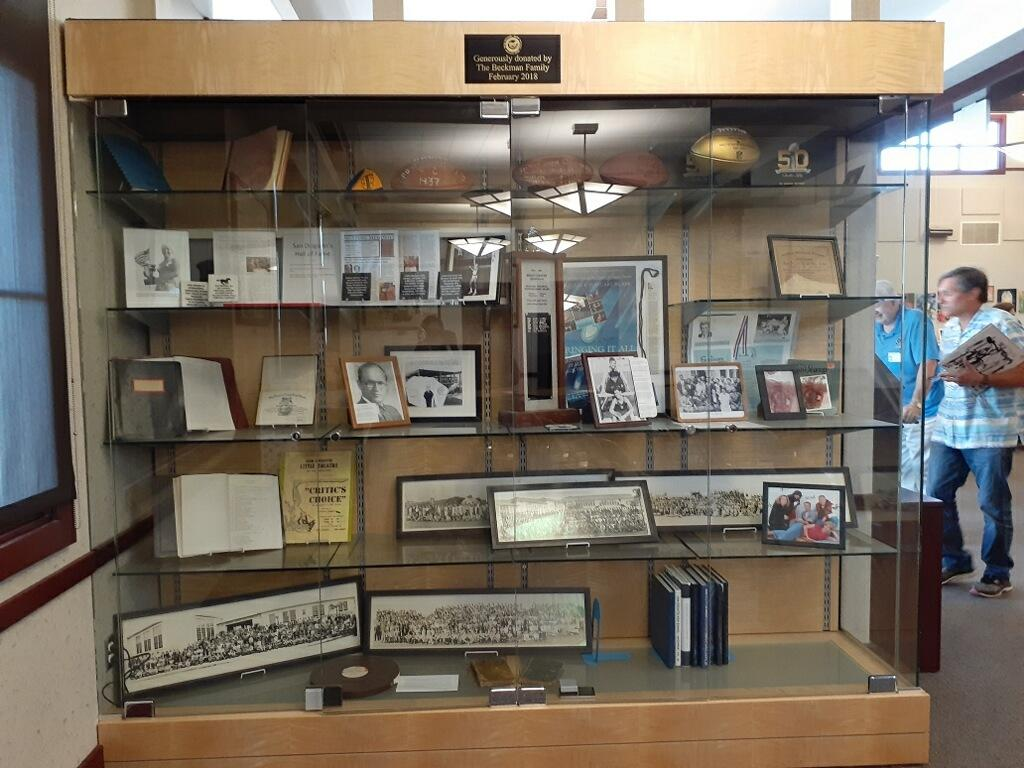 Cabinet with photos, news clippings and other memorabilia