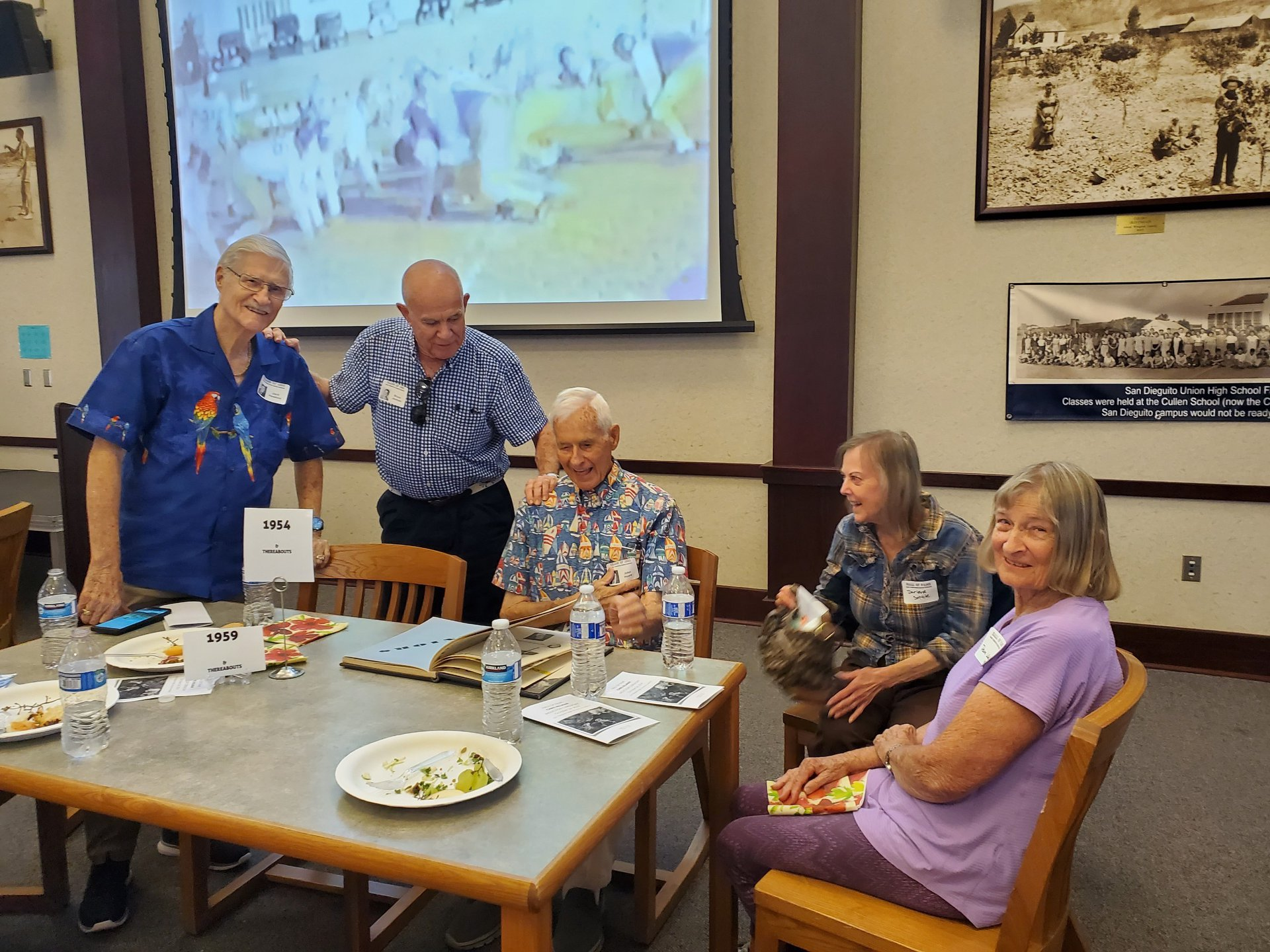 Alumni chat at table