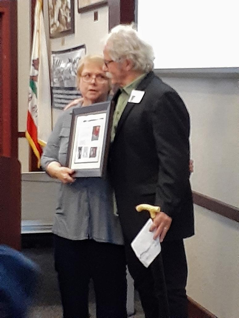 Sue presents plaque to Chris