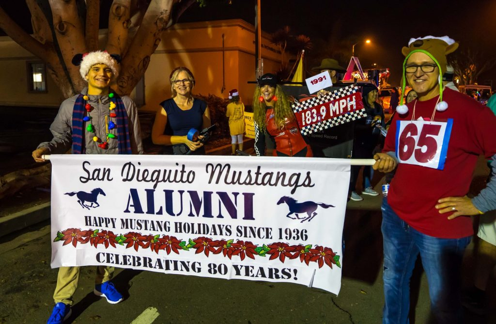 Parade banner held by alumni with