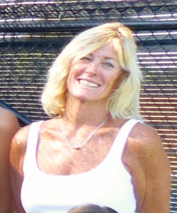 Coach Deb in front of courts